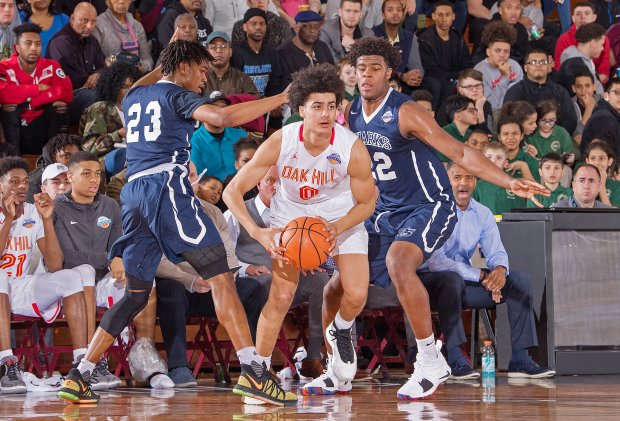 Trey Doomes and Vernon Carey Jr. of University attempt to trap Will Richardson of Oak Hill Academy.