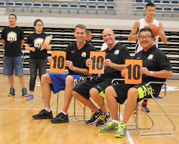Basketball coaches (L-R) Tim Kennedy, Frank Allocco and Harvey Kitani double as slam dunk contest judges at the Nike High School Elite Camp in Shangai.