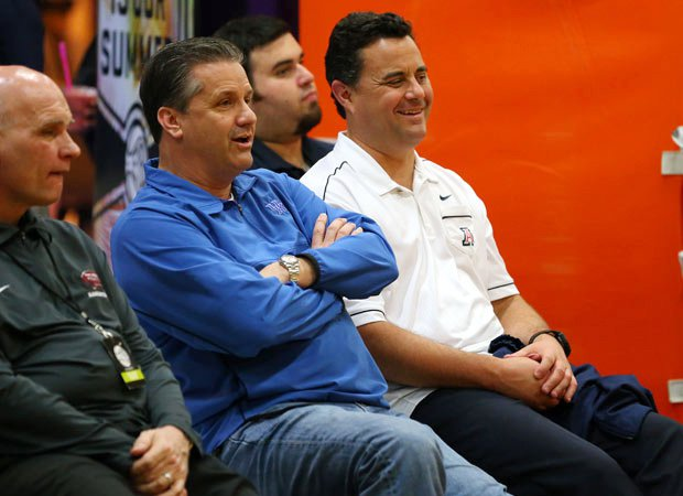 Kentucky's John Calipari (center) chats with Arizona's Sean Miller (right) on Saturday during action at the Elite Youth Basketball League in Sacramento. Many of the nation's top college coaches were on hand this weekend to view some of the nation's top high school prospects.