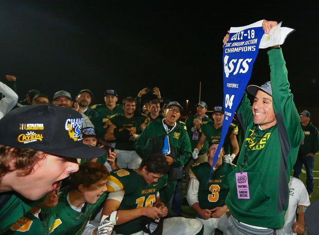 Placer coach Joey Montoya holds up banner, signaling his team's first Sac-Joaquin Section title since 1981.