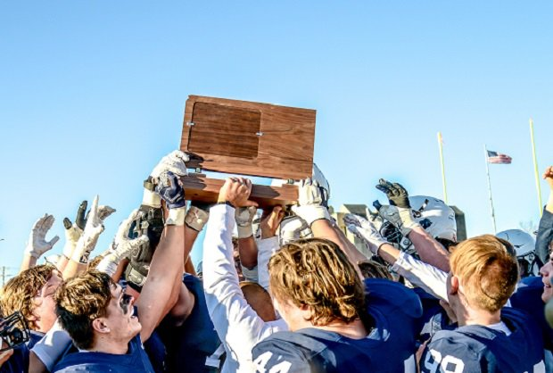 MIll Valley hoists its Kansas 5A trophy.