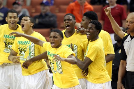 Madison players celebrate as the clock ticks down during their title-game victory over Yates.