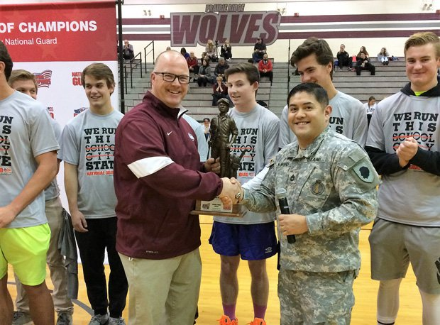 Chris Schremp accepts the Minuteman Trophy as part of the Tour of Champions presented by the Army National Guard.