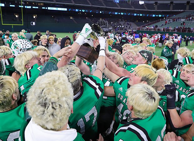 Southlake Carroll players hoist the trophy following their upset victory over Duncanville on Saturday at Globe Life Park.