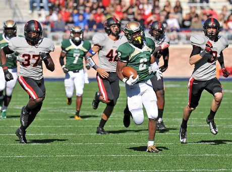 Dontre Wilson (2) runs past the Coppell defense en route to a 204-yard rushing game in DeSoto's surprising 42-14 5A Texas playoff win in a battle of nationally ranked teams.
