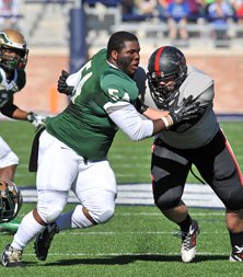 DeSoto defensive lineman Bryce English loses his helmet in  pursuit of Colby Mahon.