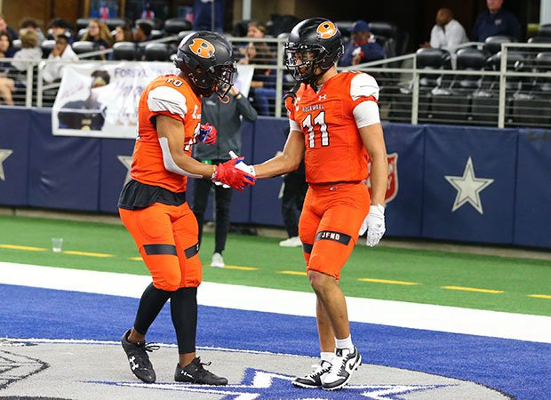 Jaxon Smith-Njigba (11) receives congratulations for one of his six touchdowns, five receiving, in Friday's 60-59 win over Allen.
