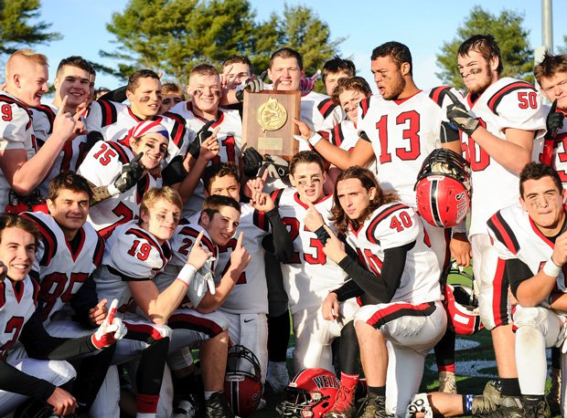 Wells and coach Tim Roche won the 2016 Maine Class C state football championship.