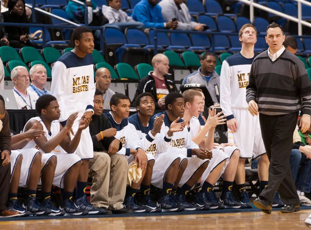 Head coach Andy Muse (far right) and Mount Tabor re-enter the rankings after a big win over Davie.