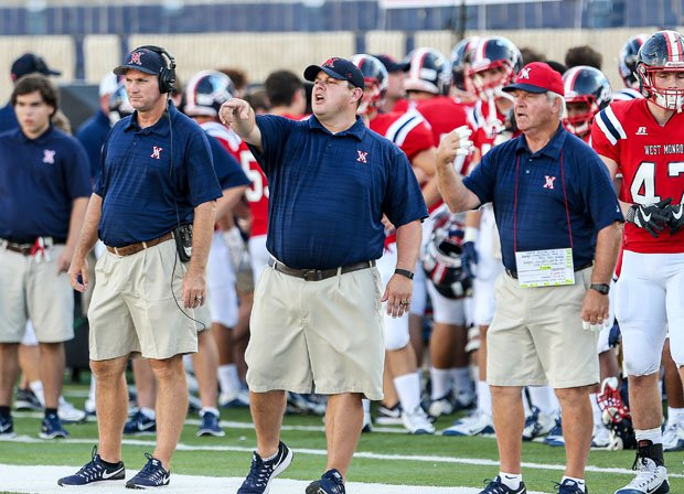 The West Monroe football coaching staff flashes instruction in the 2016 state title game versus John Curtis.