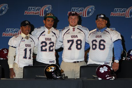 Taurean Ferguson (11), Chase Abbington (22), Jake Thomas (78) and Jacob Hyde (66) pose at the 2013 USA Football Signing Day Breakfast at The Renaissance Hotel Austin on Wednesday.