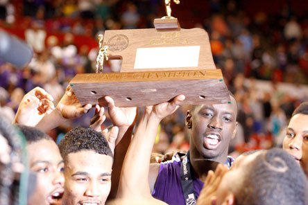 Nebraska prep basketball fans should be used to this sight: Omaha Central hoists its third-straight title trophy.