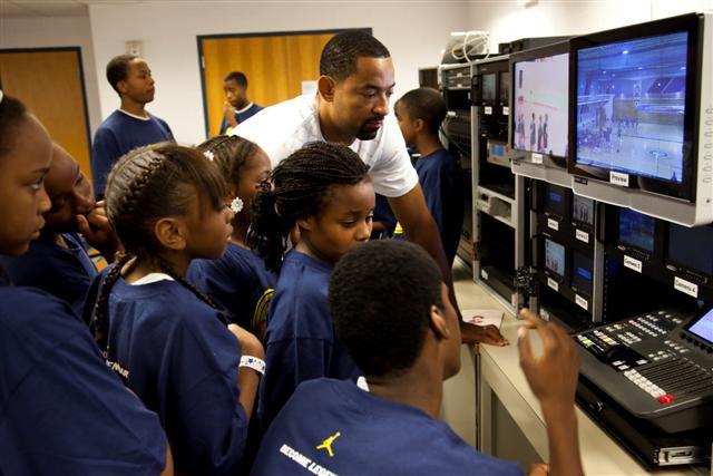 Howard tests campers' broadcasting skills.