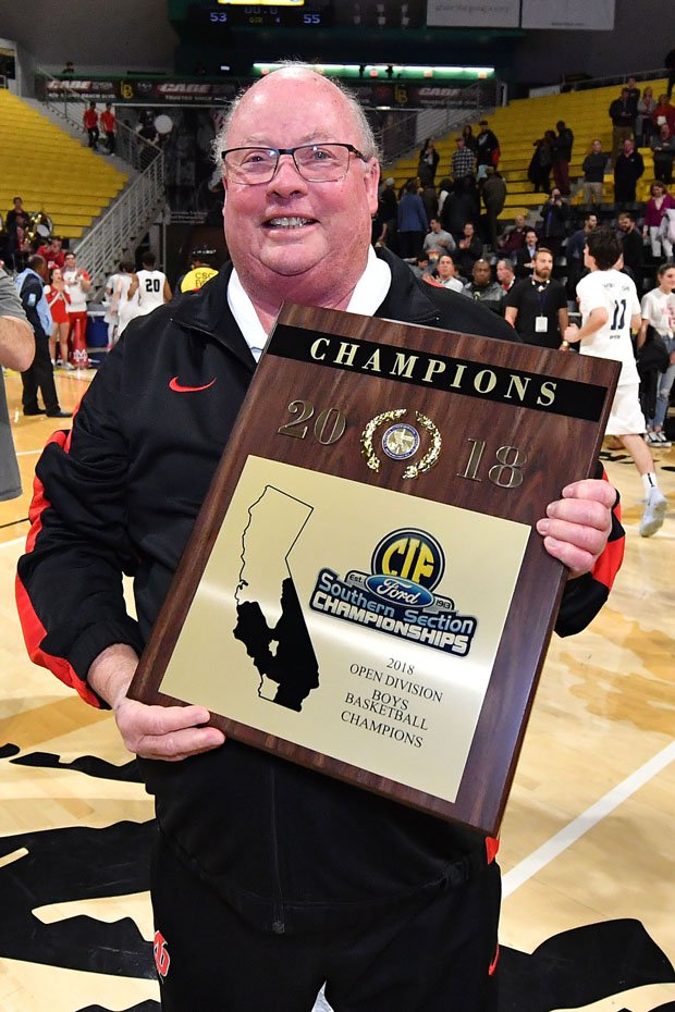 Mater Dei coach Gary McKnight with more hardware.