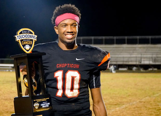 Chopticon starting quarterback Anthony Hunt posing with the 2017 Touchdowns Against Champions National Champions trophy.