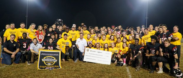 The Chopticon football and cheerleading teams, along with their coaches, all join forces to celebrate their national Touchdowns Against Cancer titles for raising the most money to fight pediatric cancer.