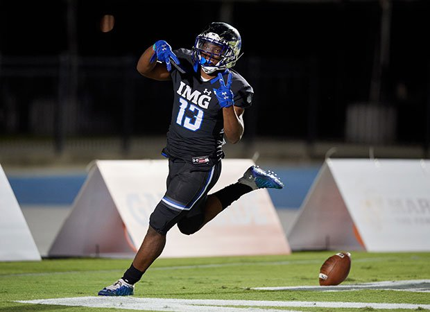 Kaytron Allen celebrates one of his five touchdowns for IMG.