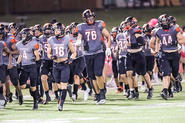 Logan Cluff-Amperse takes the field Oct. 8 with his Rockwall teammates prior to a huge win over Southlake Carroll.