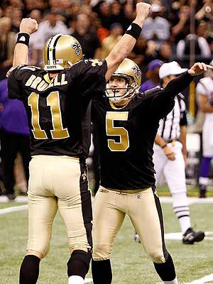 Kicker Hartley celebrates with holder Mark Brunell.