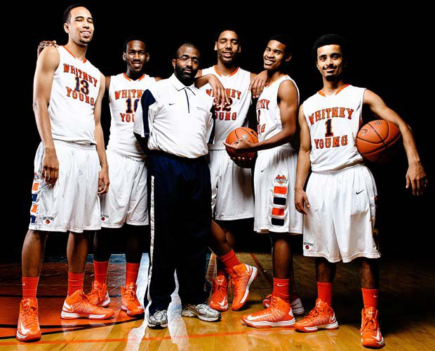 Whitney Young head coach Tyrone Slaughter is surrounded by players (left to right): Paul White, L.J. Peak, Jahlil Okafor, Miles Reynolds and Ausar Madison.