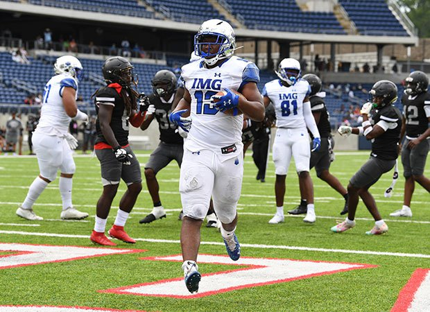 Running back Kaytron Allen scores one of his two rushing touchdowns for IMG.
