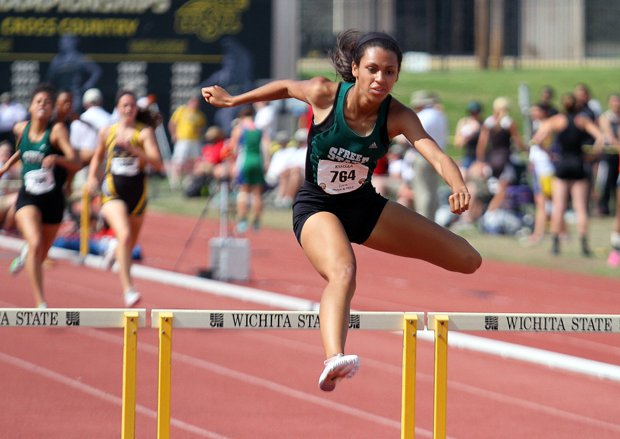Alexa Harmon-Thomas (shown here winning the Class 6A state title in the 300-meter hurdles last season) has established herself as a world-class track athlete. She is the daughter of the late Derrick Thomas, an NFL Hall of Fame linebacker.