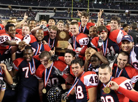 In the last football celebration of the season, Allen poses following its Texas 5A Division I over Lamar Saturday night at Cowboys Stadium.