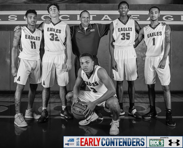 Head coach David Martinez (middle) is surrounded by players Carsen Edwards (kneeing); and (left to right) Greg Shead, Matt Willrodt, Fabian White and Brandon Brooks-Loville.