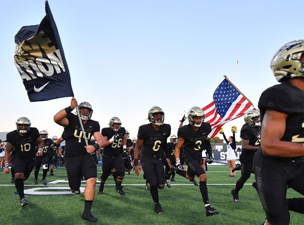 St. John Bosco takes the field in its home opener vs. DeMatha.