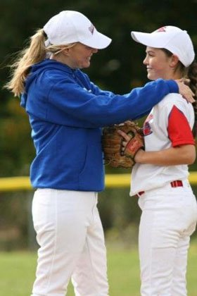 Justine Siegal counsels Chelsea Baker on the mound.