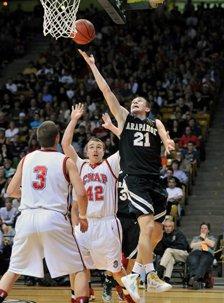 Arapahoe's Zach Kocur (21) rebounds against Chaparral.