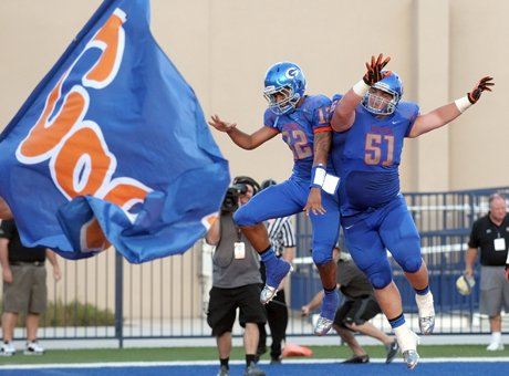 Bishop Gorman quarterback Anu Solomon (12) and Zach Singer (51) celebrate a touchdown during its 27-22 win over Good Counsel on Friday.