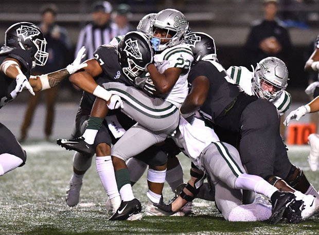 De La Salls running back James Coby is sandwiched by two Bosco defenders.
