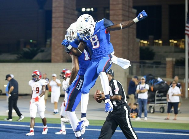 Allen's Ja'Juan Mason and Theo Wease celebrate during the Eagles' 40-0 win on Friday.
