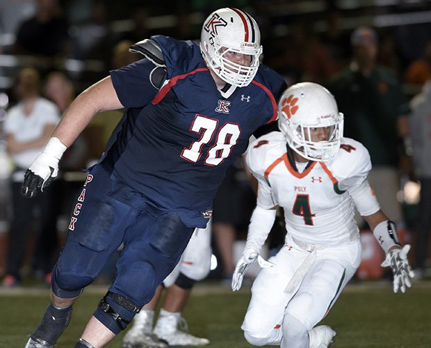 King lineman John Krahn towers over a Riverside-Poly player during last Friday's home game.