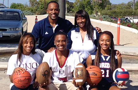 The Carrington family is loaded with athletic talent in San Diego: Darren Sr. (Back left), Vickie (Back right), DiArra (Front left), Darren Jr. (middle) and DiJonai (Front right).