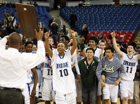 Sacred Heart Cathedral coach Darrell Barbour holds up the CIF Northern California Division III plaque last year after a victory over Bishop O'Dowd. DeOndre Otis (10) wants to hold the hardware first.