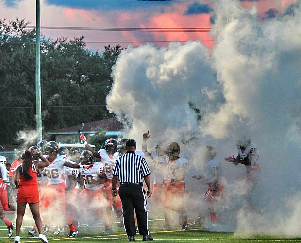 As the sun set on Miami, Washington emerged from the smoke and its dressing room before Friday's showdown with Central at Traz Powell Stadium.