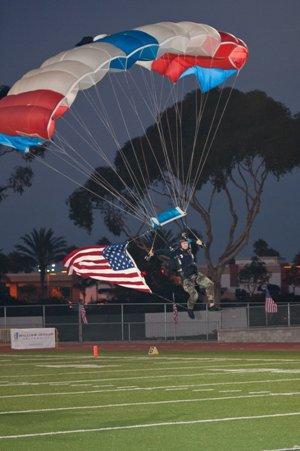 A paratrooper enters the Oceanside High field Friday.