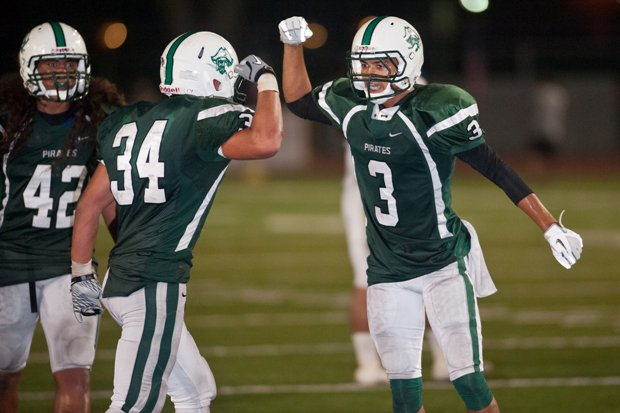 Jace Whittaker (right) and Josh Bernard celebrate Friday for Oceanside.
