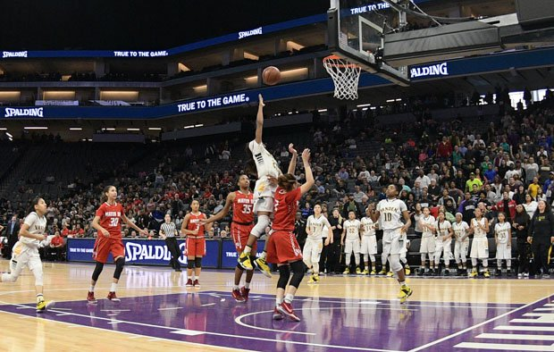 Julia Blackshell-Fair with her game-winning basket following steal at midcourt.