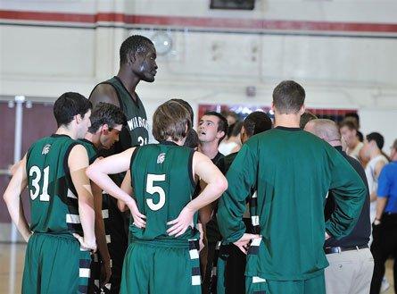 Ndiaye towers over his teammates at Brethren Christian in Huntington Beach, Calif.