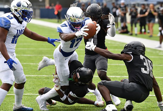 An IMG Academy player reaches for the end zone during his team's 58-0 thrashing of Bishop Sycamore in August.