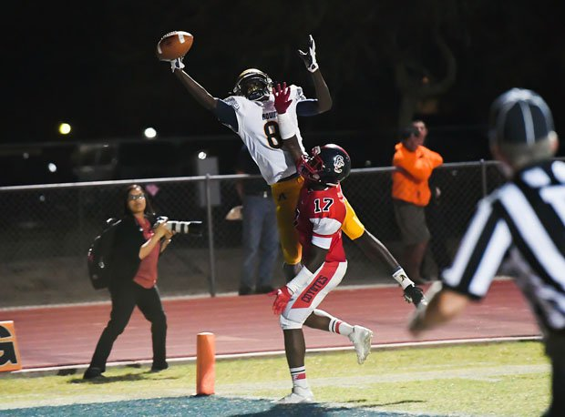 St. Thomas Aquinas receiver Teriq Phillips goes up high but can't come down with a potential touchdown grab.