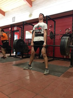 In addition to track and field and football, Lee  competes in powerlifting for his school.