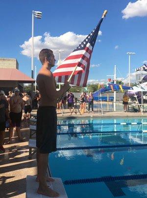 Before a big meet, Richard Kovalcik holds flag.