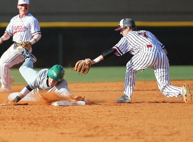 Leo Albano of Bishop England slides in safe.