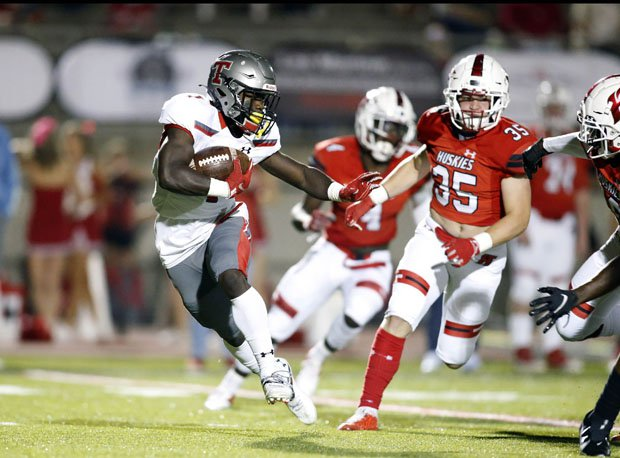 Thompson's Sam Reynolds avoids would-be Hewitt-Trussville tacklers in Friday's Alabama showdown.