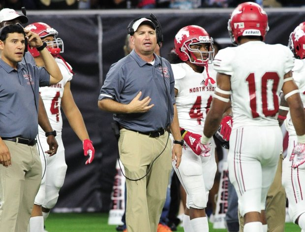 Head coach Jon Kay instructs his North Shore Mustangs during a November playoff game with Houston-area rival Katy.