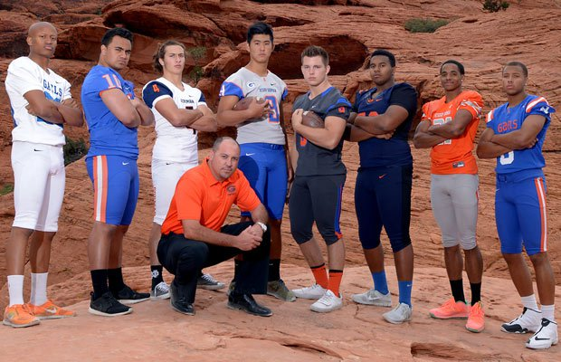 With Red Rock Canyon National Conservation Area as the backdrop, Bishop Gorman head coach Tony Sanchez gathers with some of his top players for the 2014 season.